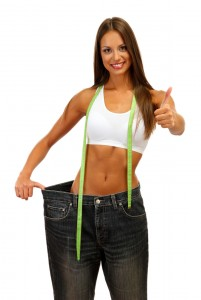 beautiful young woman with big jeans and measuring tape,